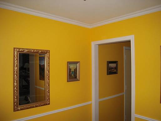 Hallway with crown molding & wainscotting